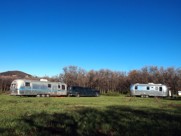 Two airstreams in a meadow