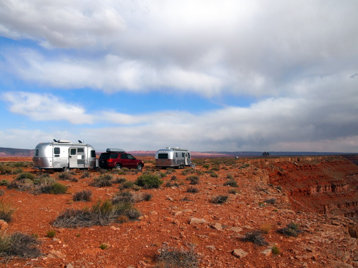Two airstreams at the edge of a cliff